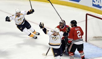 The Nashville Predators celebrate a goal by Nashville Predators defenseman Ryan Ellis (4) during the first period in Game 2 of a first-round NHL hockey playoff series, Saturday, April 15, 2017, in Chicago. (AP Photo/David Banks)