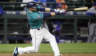 Seattle Mariners' Mitch Haniger hits an RBI single against the Texas Rangers during the seventh inning of a baseball game Friday, April 14, 2017, in Seattle. (AP Photo/Elaine Thompson)