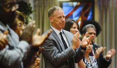 "San Bernardino City Unified School District Superintendent Dale Marsden applauds Rod Smith Jr., son of North Park Elementary School shooting victim Karen Smith, after singing an emotion tribute ""Give Me Jesus,"" in honor of Smith's memory during a memorial service at Grace Chapel in San Bernardino, Calif., Friday, April 14, 2017. Several hundred people attended the memorial service for teacher Karen Smith after her estranged husband Cedric Anderson entered North Park Elementary, killing Smith, eight-year-old student Jonathan Martinez and wounding nine-year-old student Nolan Brandy on April 10 in San Bernardino. (Rachel Luna/Los Angeles Daily News via AP)"
