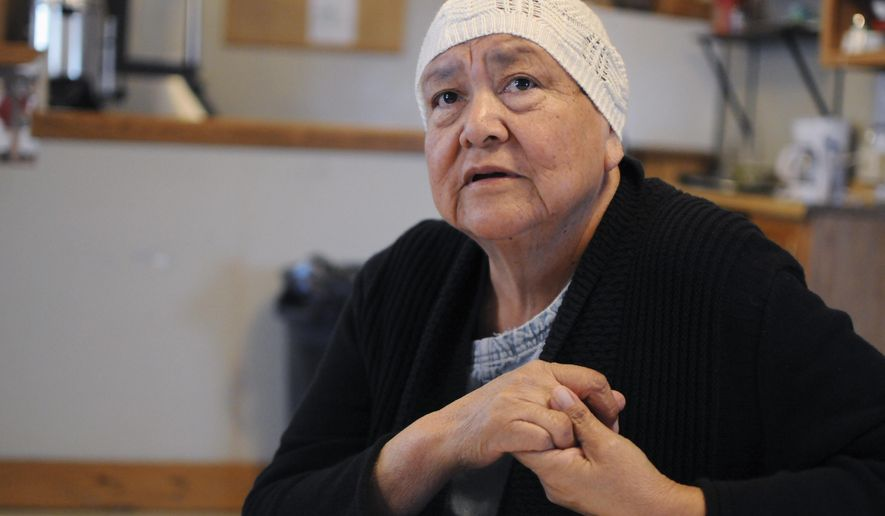 In this March 29, 2017 photo, Rosebud Sioux Tribe member Eva Iyotte discusses an energy assistance program that faces elimination under President Donald Trump in White River, S.D. (AP Photo/James Nord)