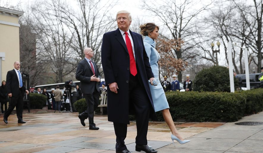 FILE - In this Jan. 20, 2017 file photo, then-President-elect Donald Trump and his wife Melania walk to their vehicle after attending church service at St. John's Episcopal Church across from the White House in Washington. At Washington churches, presidents have long been seated in the pews. Bill and Hillary Clinton favored a Methodist church. Jimmy Carter taught Baptist Sunday School. And Barack Obama dropped in at an Episcopal church next to the White House. But as Easter Sunday approaches, President Donald Trump has not attended a church service in the Capitol since the worship events during his inauguration weekend. (AP Photo/Pablo Martinez Monsivais, File)