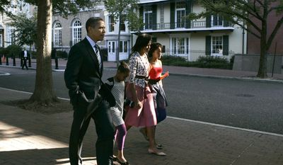 FILE - In this Oct. 11, 2009 file photo, President Barack Obama, first lady Michelle Obama and their, children Sasha, second from left, and Malia, right, walk back to the White House after attending St. John's Episcopal Church in Washington. At Washington churches, presidents have long been seated in the pews. Bill and Hillary Clinton favored a Methodist church. Jimmy Carter taught Baptist Sunday School. And Barack Obama dropped in at an Episcopal church next to the White House. But as Easter Sunday approaches, President Donald Trump has not attended a church service in the Capitol since the worship events during his inauguration weekend. (AP Photo/Susan Walsh, File)