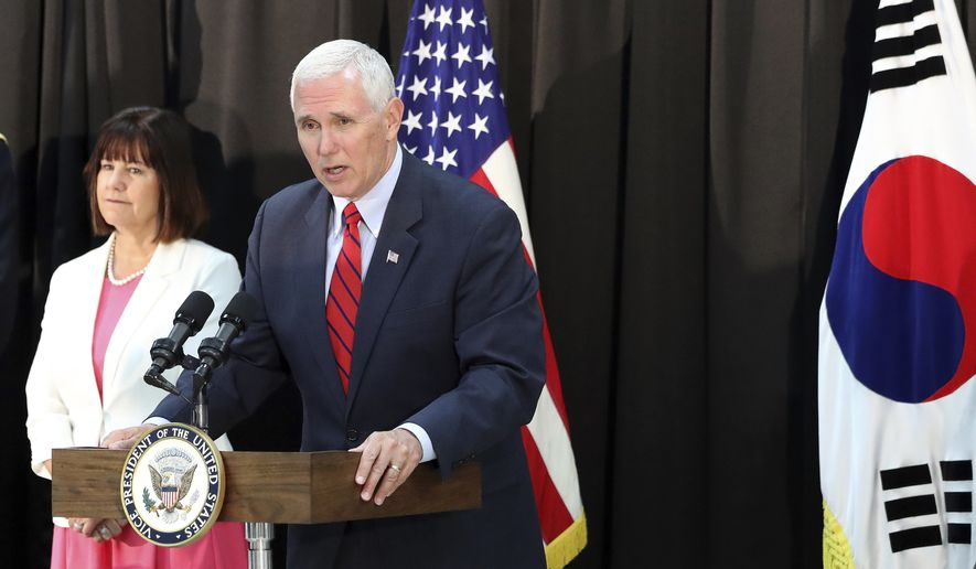 "U.S. Vice President Mike Pence speaks as his wife Karen Pence listens during a dinner with soldiers and family members after Easter Sunday church services at a military base in Seoul, South Korea, Sunday, April 16, 2017. Pence said Sunday that North Korea's ""provocation"" underscored the risks faced by American and South Korean service members, hours after the North conducted a failed missile launch shortly before Pence's arrival. (AP Photo/Lee Jin-man)"