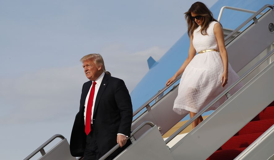 President Donald Trump with first lady Melania Trump walk down the steps of Air Force One as they arrive Sunday, April 16, 2017, at Andrews Air Force Base, Md. Trump is returning from his Mar-a-Largo resort in Florida. (AP Photo/Alex Brandon)