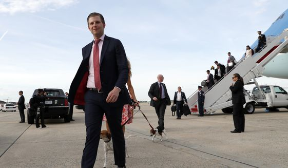 Eric Trump steps off Air Force One as he arrives Sunday, April 16, 2017, at Andrews Air Force Base, Md. President Donald Trump and family are returning from his Mar-a-Largo resort in Florida. (AP Photo/Alex Brandon)