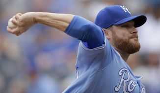 Kansas City Royals starting pitcher Ian Kennedy throws during the first inning of a baseball game against the Los Angeles Angels Sunday, April 16, 2017, in Kansas City, Mo. (AP Photo/Charlie Riedel)