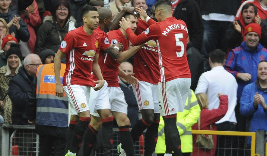 Manchester United teammates celebrate after scoring during the English Premier League soccer match between Manchester United and Chelsea at Old Trafford stadium in Manchester, Sunday, April 16, 2017.(AP Photo/ Rui Vieira)