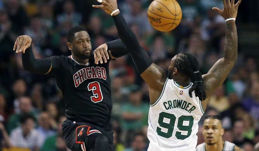 Chicago Bulls' Dwyane Wade (3) passes over Boston Celtics' Jae Crowder (99) during the fourth quarter of a first-round NBA playoff basketball game Sunday, April 16, 2017, in Boston. The Bulls won 106-102. (AP Photo/Michael Dwyer)