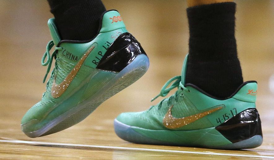 Boston Celtics' Isaiah Thomas wears a message on his shoes in memory of his sister Chyna during the fourth quarter of a first-round NBA playoff basketball game against the Chicago Bulls,Sunday, April 16, 2017, in Boston. The Bulls won 106-102. (AP Photo/Michael Dwyer)