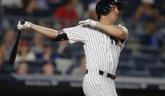 New York Yankees' Greg Bird watches as he hit a two-run home run against the St. Louis Cardinals during the second inning of a baseball game Sunday, April 16, 2017 at Yankee Stadium in New York. (AP Photo/Rich Schultz)