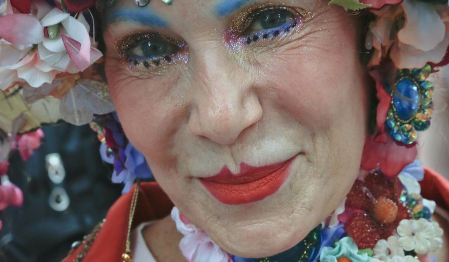 """Patricia """"Purely"""" Fox, of Manhattan, shows off her Easter bonnet that she said took 20 hours to make at the annual Easter Parade and Bonnet Festival, Sunday, April 16, 2017, in New York. (AP Photo/Bebeto Matthews)"""