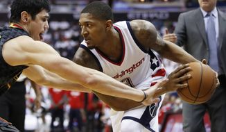 Washington Wizards guard Bradley Beal, right, is guarded by Atlanta Hawks forward Ersan Ilyasova, left,  during the first half in Game 1 of a first-round NBA basketball playoff series, in Washington, Sunday, April 16, 2017. (AP Photo/Manuel Balce Ceneta)