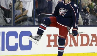 Columbus Blue Jackets' Zach Werenski celebrates his goal against the Pittsburgh Penguins during the first period in Game 3 of a first-round NHL hockey playoff series Sunday, April 16, 2017, in Columbus, Ohio. (AP Photo/Jay LaPrete)