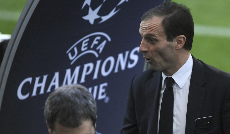 FILE - In this file photo dated Tuesday, Feb. 21, 2017, Juventus head coach Massimiliano Allegri leaves the pitch during a visit to FC Porto's Dragao stadium in Porto, Portugal, before their Champions League round of 16, first leg, soccer match.  Juventus face Barcelona in a Champions League clash upcoming Wednesday April 19, 2017, with Barca playing at home but needing to fight hard to advance in the competition. (AP Photo/Paulo Duarte, FILE)