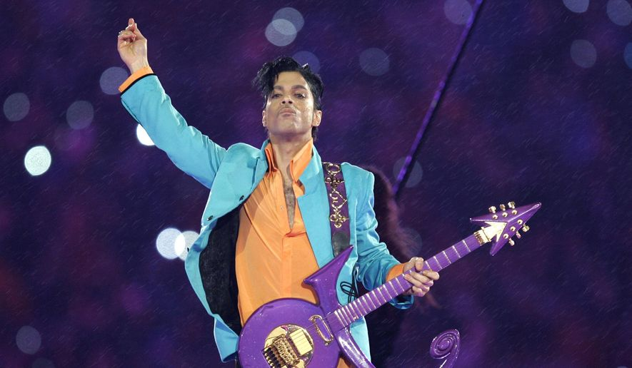 In this Feb. 4, 2007, file photo, Prince performs during the halftime show at the Super Bowl XLI football game in Miami. Nearly a year after Prince died from an accidental drug overdose in his suburban Minneapolis studio and estate, investigators still haven't interviewed a key associate nor asked a grand jury to investigate potential criminal charges, according to an official with knowledge of the investigation. (AP Photo/Chris O'Meara, File)