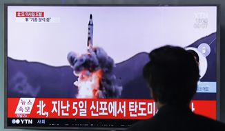 "A man watches a TV showing file footage of a North Korea's ballistic missile at Seoul Railway Station in Seoul, South Korea, Sunday, April 16, 2017. A North Korean missile exploded during launch Sunday from the country's east coast, U.S. and South Korean officials said, a high-profile failure that comes as a powerful U.S. aircraft carrier approaches the Korean Peninsula in a show of force. The letters on the top read ""North Korea, Fire missile."" (AP Photo/Ahn Young-joon)"