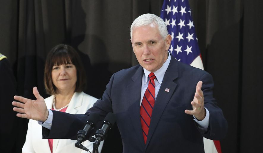 U.S. Vice President Mike Pence speaks as his wife Karen Pence listens during a dinner with soldiers and family members after Easter Sunday church services at a military base in Seoul, South Korea, Sunday, April 16, 2017. Pence arrived in South Korea on Sunday to begin a 10-day trip to Asia that comes amid turmoil on the Korean Peninsula over North Korea's threats to advance its nuclear and defense capabilities, and just after a failed missile launch by the North. (AP Photo/Lee Jin-man)