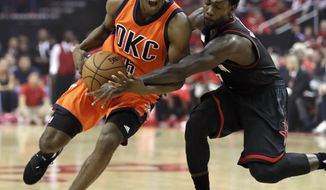 Oklahoma City Thunder's Semaj Christon (6) is fouled by Houston Rockets' Patrick Beverley, right, during the first half in Game 1 of an NBA basketball first-round playoff series, Sunday, April 16, 2017, in Houston. (AP Photo/David J. Phillip)