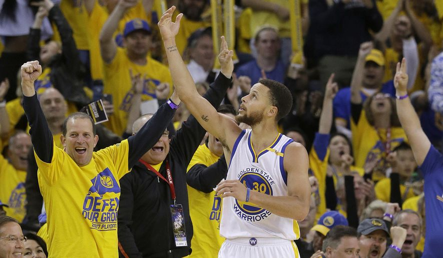 Golden State Warriors guard Stephen Curry (30) celebrates after scoring against the Portland Trail Blazers during the second half of Game 1 of a first-round NBA basketball playoff series in Oakland, Calif., Sunday, April 16, 2017. The Warriors won 121-109. (AP Photo/Jeff Chiu)