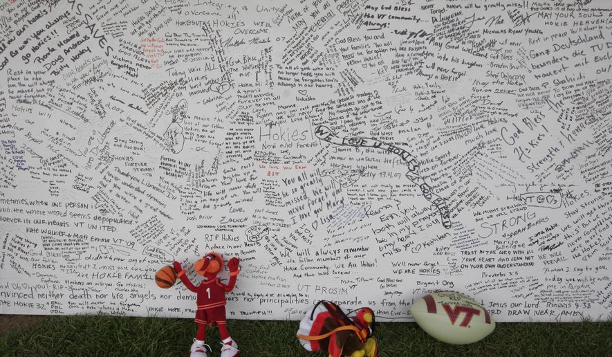 In this April 28, 2007, file photo, a memorial board sits under a tent with items that were placed in front of it, on the Drillfield on the Virginia Tech campus in Blacksburg, Va. Ten years after a mentally ill student fatally shot 32 people at Virginia Tech, survivors and families of the slain are returning to campus to honor the lives that were lost that day. Virginia Tech is holding a series of events Sunday, April 16, 2017, to mark the anniversary of the deadly campus shooting on April 16, 2007. (AP Photo/Alex Brandon, File)