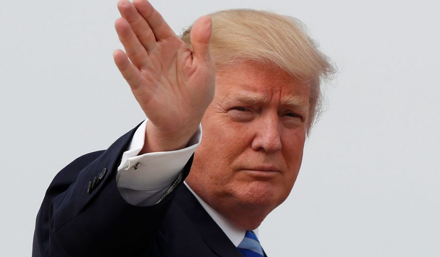 President Trump's approval rating have hit 50 percent, says a new Rasmussen Reports poll.  On Inaguration Day they were at 59. (Associated Press)