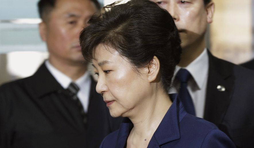 In this March 30, 2017, file photo, former South Korean President Park Geun-hye arrives at the Seoul Central District Court for a hearing on a prosecutors' request for her arrest for corruption, in Seoul, South Korea. South Korean prosecutors on Monday, April 17, 2017, indicted Park on high-profile corruption charges that could potentially send her to jail for life. (AP Photo/Ahn Young-joon, Pool, File)