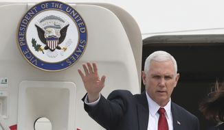 U.S. Vice President Mike Pence waves before leaving for Japan, at Osan Air Base in Pyeongtaek, South Korea, Tuesday, April 18, 2017. (AP Photo/Lee Jin-man)