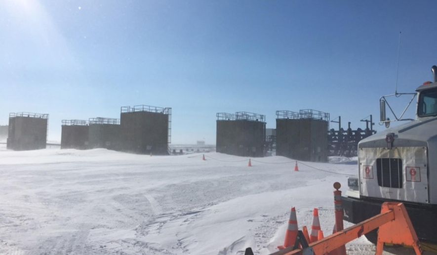 This April 2017 photo provided by the U.S. Environmental Protection Agency shows an oil well that was misting natural gas on Alaska's frozen North Slope. Workers from the Alaska Department of Conservation and the Environmental Protection Agency on Saturday, April 15, 2017, were able to connect hoses to valves that allow pressure in the well to be reduced, according to a statement from the state conservation department. The Environmental Protection Agency says a crack in the BP wellhead near Deadhorse sent up mist of crude oil Friday before it froze over and an initial leak stopped. (U.S. Environmental Protection Agency via AP)