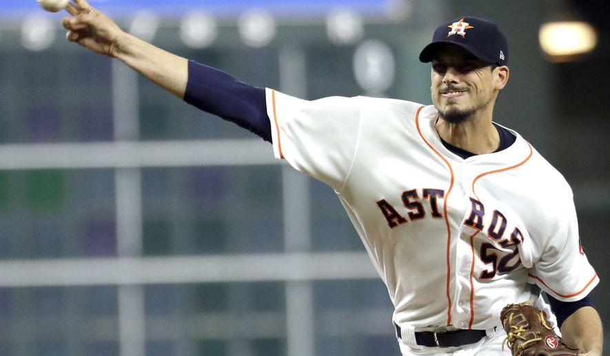 Houston Astros starting pitcher Charlie Morton throws against the Los Angeles Angels during the first inning of a baseball game, Monday, April 17, 2017, in Houston. (AP Photo/David J. Phillip)