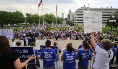 People gather at a rally opposing the state's upcoming executions, on the front steps of Arkansas' Capitol, Friday, April 14, 2017, in Little Rock, Ark. (Stephen B. Thornton/The Arkansas Democrat-Gazette via AP)