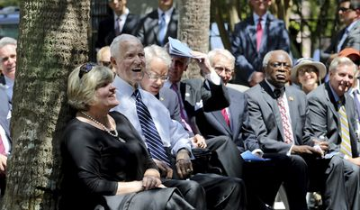 Former senator and South Carolina governor Fritz Hollings joined by Charleston Mayor John Tecklenburg, Gov. Henry McMaster,former Charleston Mayor Joe Riley, U.S. Rep Jim Clyburn and Sen. Lindsey Graham at the ceremony to unveil the statue of Hollings in the garden of the J. Waties Waring Judicial Center Monday April 17, 2017 in Charleston.,S.C.  (Grace Beahm/The Post And Courier via AP)