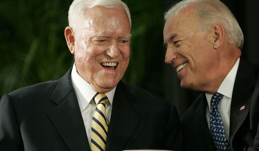 FILE - In this Friday, July 23, 2010, file photo, Vice President Joe Biden chats with former U.S. Sen. Ernest Fritz Hollings during the dedication ceremony of the new Ernest F. Hollings Special Collections Library in Columbia, S.C. Hollings is being honored outside the federal courthouse in Charleston that used to bear his name. Biden is the main speaker Monday, April 17, 2017, at the dedication of a Hollings statue outside the J. Waties Waring Judicial Center. Hollings made the unusual request in 2015 that Congress rename the building for the civil rights-era judge. (AP Photo/Mary Ann Chastain, File)
