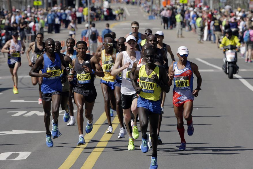Emmanuel Mutai, of Kenya, leads the pack along the course of the 121st Boston Marathon on Monday, April 17, 2017, in Framingham, Mass. (AP Photo/Steven Senne)