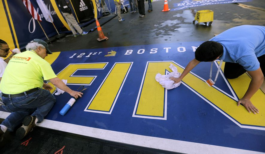 Workers make final preparations of the finish line before the 121st Boston Marathon on Monday, April 17, 2017, in Boston. (AP Photo/Elise Amendola)