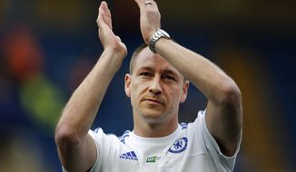 FILE- In this Sunday, May 15, 2016 file photo, Chelsea's John Terry applauds to supporters after the English Premier League soccer match between Chelsea and Leicester City at Stamford Bridge stadium in London. Captain Terry is to leave Chelsea at the end of the season after spending his entire career at the London club. (AP Photo/Frank Augstein)