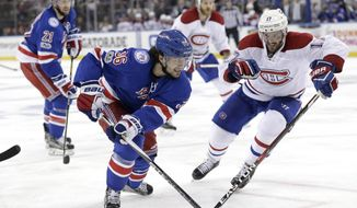 New York Rangers' Mats Zuccarello, left, chases the puck during the second period in Game 3 of an NHL hockey first-round playoff series against the Montreal Canadiens, Sunday, April 16, 2017, in New York. (AP Photo/Seth Wenig)