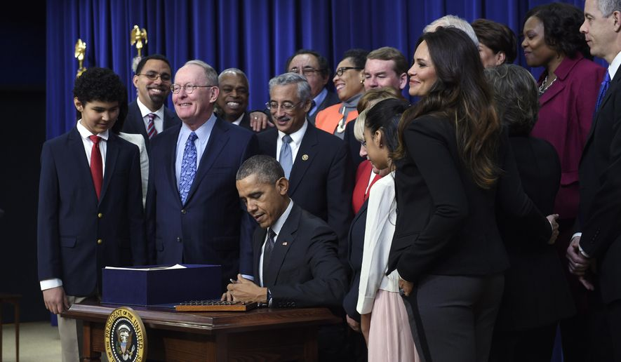 """FILE - In this Dec. 10, 2015 file photo, President Barack Obama signs the """"Every Student Succeeds Act,"""" a major education law setting U.S. public schools on a new course of accountability, in Washington. States are grappling with as they are working to submit blueprints of how they will implement the Every Student Succeeds Act, or ESSA, a landmark education law meant to help struggling schools. The law allows states greater flexibility in dealing with low performing schools, but the flexibility also comes with the risk or doing too little, too much or too differently. (AP Photo/Susan Walsh, File)"""