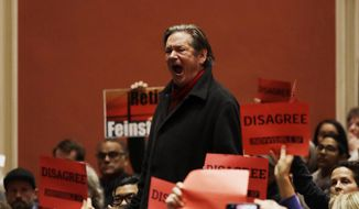 A man shouts at Sen. Dianne Feinstein, D-Calif., as she speaks during a town hall meeting with constituents Monday, April 17, 2017, in San Francisco . (AP Photo/Marcio Jose Sanchez)