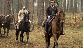 "This image released by Open Road Films shows Christian Bale, left, and Oscar Isaac in a scene from ""The Promise."" (Jose Haro/Open Road Films via AP)"
