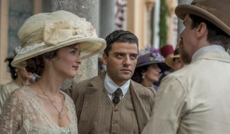 """This image released by Open Road Films shows Charlotte Le Bon, from left, Oscar Isaac and Christian Bale in a scene from """"The Promise."""" (Jose Haro/Open Road Films via AP)"""