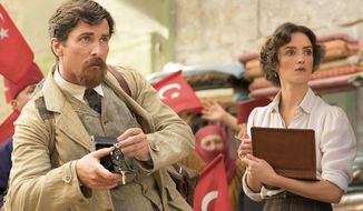 "This image released by Open Road Films shows Charlotte Le Bon, right, and Christian Bale in a scene from ""The Promise."" (Jose Haro/Open Road Films via AP)"