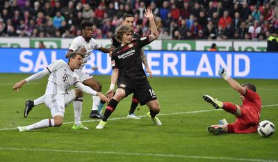 Bayern's Thomas Mueller, left, misses to score against Leverkusen goalkeeper Bernd Leno, right, during the German Bundesliga soccer match between Bayer Leverkusen and Bayern Munich in Leverkusen, Germany, Saturday, April 15, 2017. (AP Photo/Martin Meissner)
