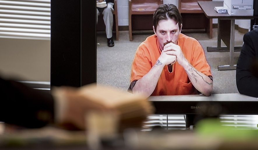 Joseph Jakubowski appears in court via video Monday, April 17, 2017, at the Rock County Courthouse in Janesville, Wis. Jakubowski was arrested Friday morning on the farmland near Readstown, Wis. That's where the manhunt began after authorities say Jakubowski broke into a gun store last week and sent a threatening manifesto to the White House.  (Angela Major/The Janesville Gazette via AP)