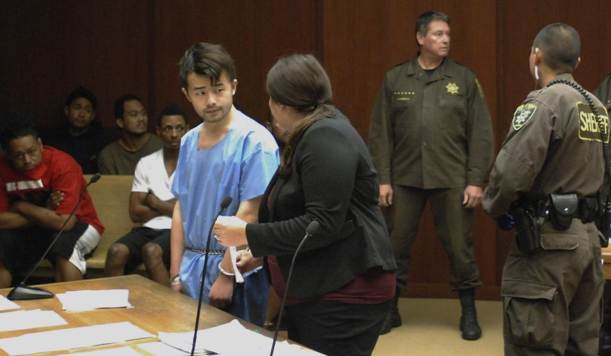 Yu Wei Gong, left, speaks to Deputy Public Defender Diamond Grace in court in Honolulu on Monday, April 17, 2017. The Hawaii man accused of killing his mother months ago stuffed her decapitated head and dismembered body parts in several plastic bags in the refrigerator freezer of the Waikiki apartment they shared, according to court documents made public ahead of the suspect's first court appearance. (AP Photo/Jennifer Sinco Kelleher)