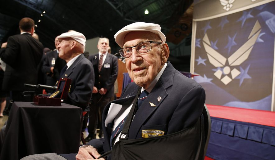 "In this April 18, 2015, file photo, two members of the Doolittle Tokyo Raiders, retired U.S. Air Force Lt. Col. Richard ""Dick"" Cole, seated front, and retired Staff Sgt. David Thatcher, seated left, pose for photos after the presentation of a Congressional Gold Medal honoring the Doolittle Tokyo Raiders at the National Museum of the U.S. Air Force at Wright-Patterson Air Force Base in Dayton, Ohio. (AP Photo/Gary Landers, File)"