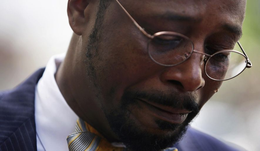 Norfolk, Va., treasurer Anthony Burfoot gets emotional as pauses to talk with the media prior to entering U.S. District Court for his sentencing on Monday, April 17, 2017. Burfoot was sentenced to six years in federal prison on public corruption and perjury charges. (Vicki Cronis-Nohe/The Virginian-Pilot via AP)
