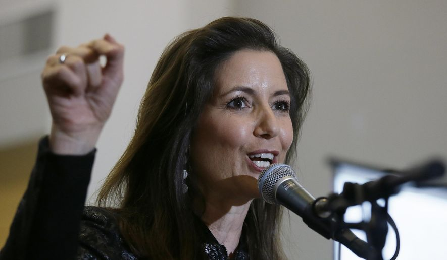 In this March 25, 2017 photo, Oakland Mayor Libby Schaaf gestures during a rally at the Oakland Coliseum in Oakland, Calif. Schaaf announced a run for reelection Monday, April 17, 2017, and that she plans to seek a second term as mayor. Schaaf became Oakland's 50th mayor in January 2015 after serving one term as a city council member. (AP Photo/Eric Risberg)
