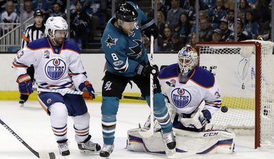 Edmonton Oilers goalie Cam Talbot (33) stops a shot from San Jose Sharks center Joe Pavelski (8) next to Oilers center David Desharnais (13) during the first period in Game 3 of a first-round NHL hockey playoff series, Sunday, April 16, 2017, in San Jose, Calif. (AP Photo/Marcio Jose Sanchez)