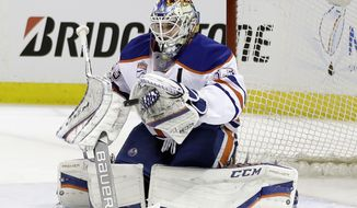 Edmonton Oilers goalie Cam Talbot (33) stops as shot against the San Jose Sharks during the first period in Game 3 of a first-round NHL hockey playoff series Sunday, April 16, 2017, in San Jose, Calif. (AP Photo/Marcio Jose Sanchez)