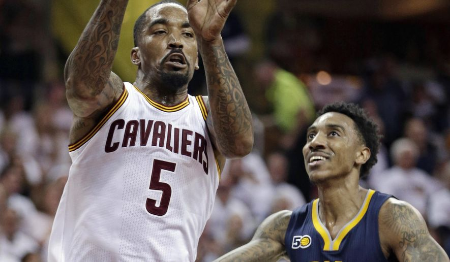 Cleveland Cavaliers' J.R. Smith (5) passes against Indiana Pacers' Jeff Teague (44) in the first half in Game 2 of a first-round NBA basketball playoff series, Monday, April 17, 2017, in Cleveland. (AP Photo/Tony Dejak)